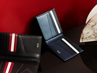 Expertly made men's leather wallets featuring the Bally Stripe