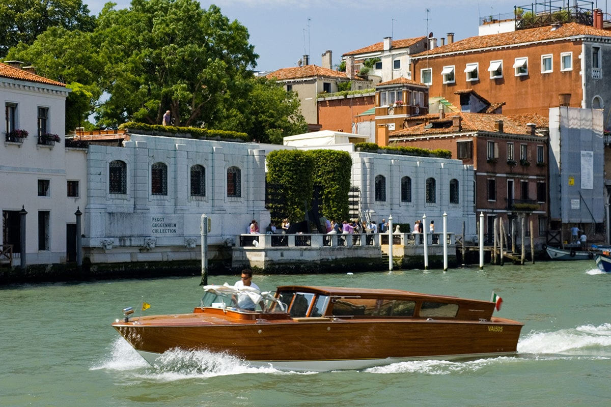 Luxury boat cruising through the waters of Venice