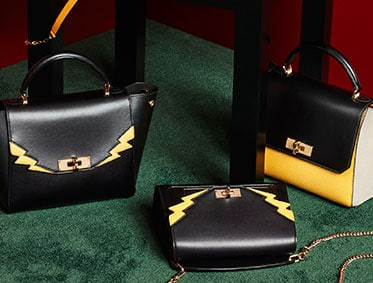 The yellow leather B-Turn minibag with a chain and leather strap – a perfect Bally gift